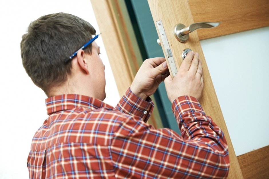 carpenter at door lock installation